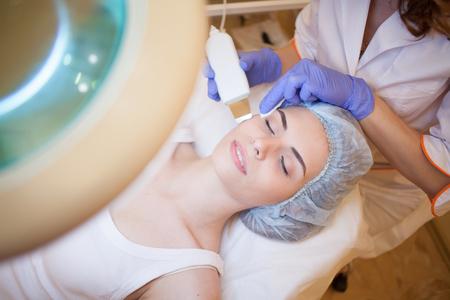 Cosmetology doctor makes facial procedures