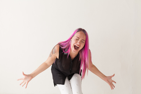 the girl with the pink hair is screaming hysterics Stock Photo