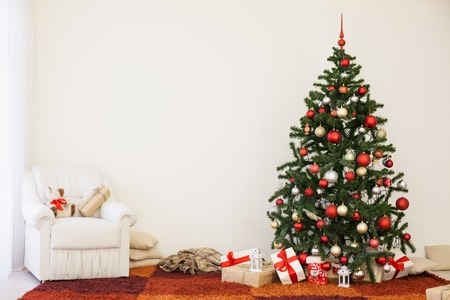 Christmas tree on new years Eve in a white room with Christmas gifts 1