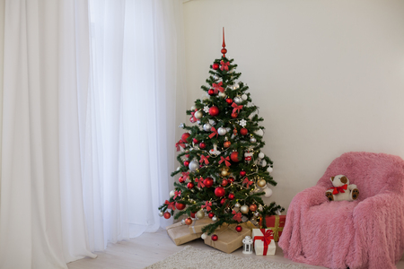 Christmas tree with presents in Christmas lights room gifts Stock Photo