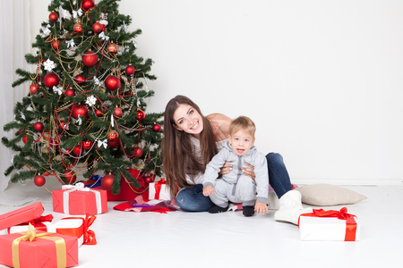 mother and son open gifts on christmas and new year stock photo 88747040