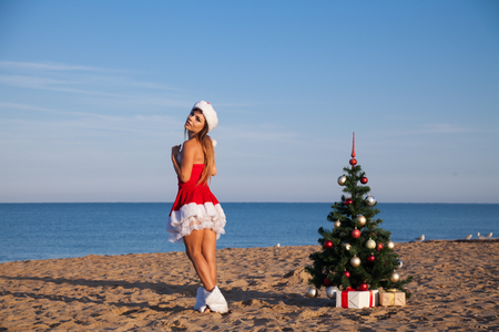 girl Christmas new year Sea Beach South Stock Photo
