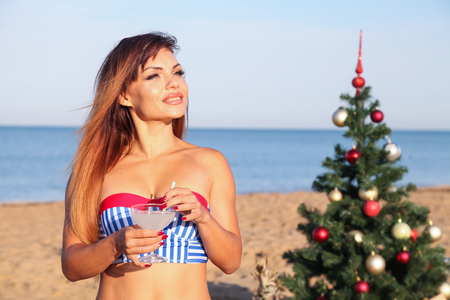 girl in a bathing suit on a beach new years Eve in the tropics