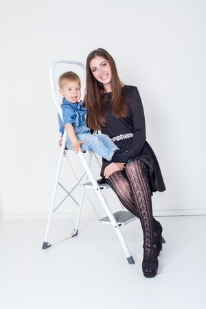 mother and young son on the stairs stepladder Stock Photo