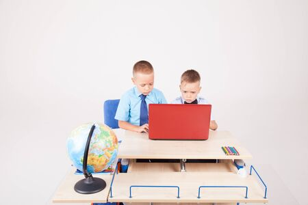 study on the computer two boys at school Stock Photo