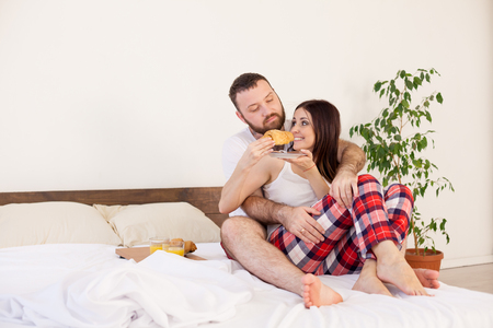man and woman breakfast in bed Stock Photo