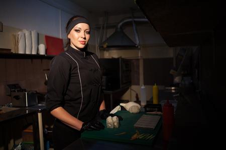 a girl prepares food sushi Banco de Imagens