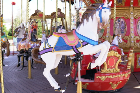 Kid attractions colorful carousel horse fun Stock Photo