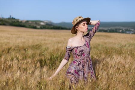a woman farmer in field of wheat before the harvest Standard-Bild