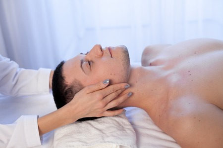 man doing medical massage hands person in Spa
