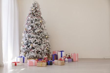 White Christmas tree in Konate with stocking-stuffers Stock Photo
