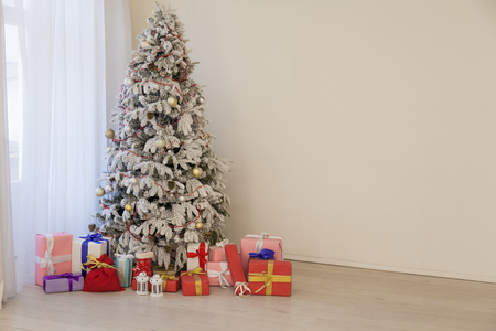 White Christmas tree in Konate with stocking-stuffers 写真素材