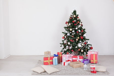 Christmas tree with presents, Garland lights new year Stock Photo