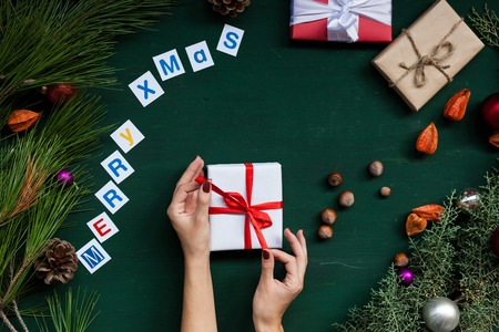 Christmas background new year gifts hands toys balls fruits nuts