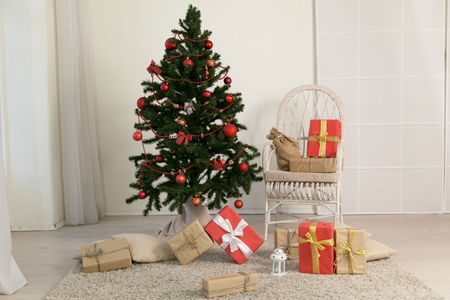 Christmas tree with presents in the room with a winter decoration for the new year