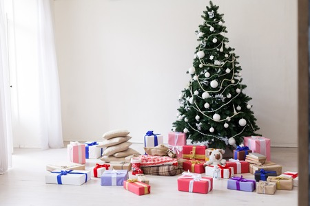 Green Christmas tree white decor gifts new year holidays Stock Photo