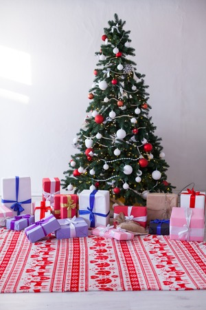 Christmas home decor with Christmas tree and gifts for the new year Stock Photo