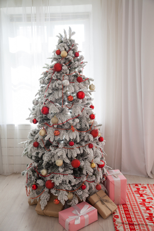 Merry Christmas tree gifts new year House Interior 免版税图像
