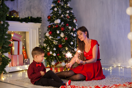 mom with son of Bengal lights lights Christmas new year gifts