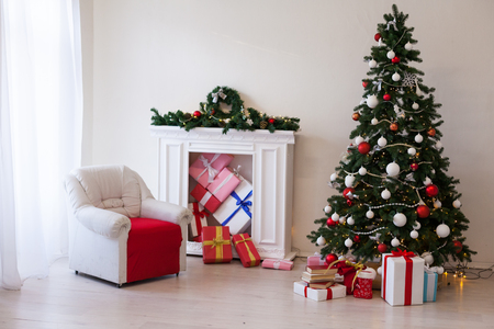 Christmas tree with presents, Garland lights new year holiday decor Stock Photo