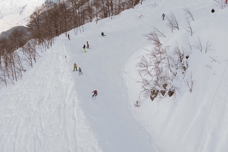 skiers and snowboarders ride on mountain slopes of the ski resort winter vacation travel Zdjęcie Seryjne