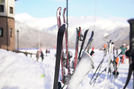 Alpine skis and Snowboards at snow ski resort vacation travel