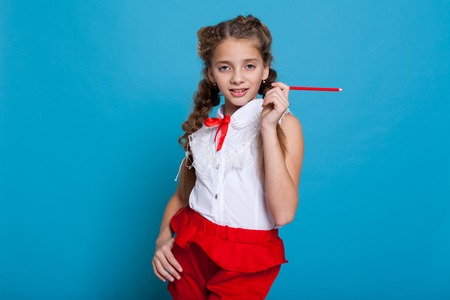 Portrait of beautiful girls with braids with a red pencil on blue background Banque d'images - 113990742