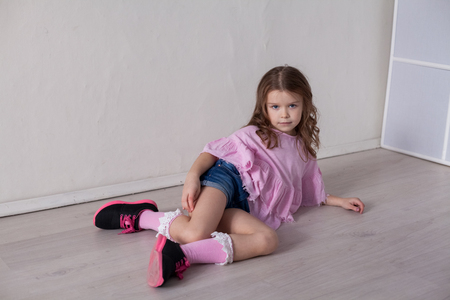 Portrait of a beautiful little girl in a pink dress five years Archivio Fotografico