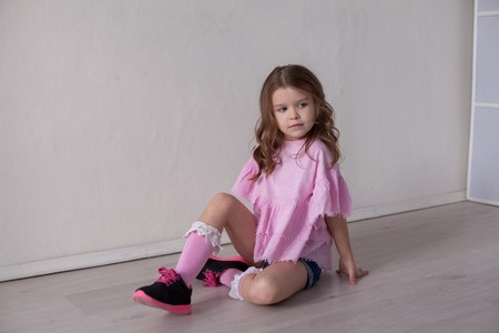 Portrait of a beautiful little girl in a pink dress five years Standard-Bild - 114245976