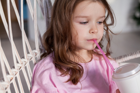 Portrait of a beautiful little girl in a pink dress five years Stock Photo