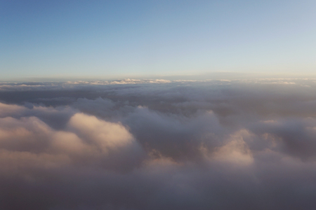 clouds at sunset from  plane sky Sun travel Stock Photo
