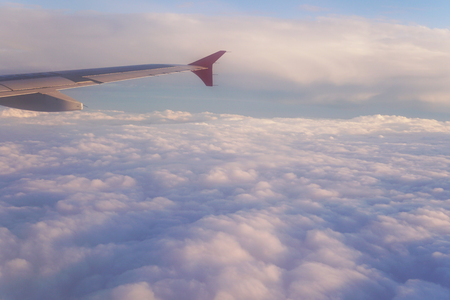 clouds at sunset from  plane sky Sun travel Stok Fotoğraf