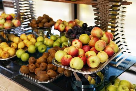 plates with fresh fruit in the kitchen citrus apples healthy food