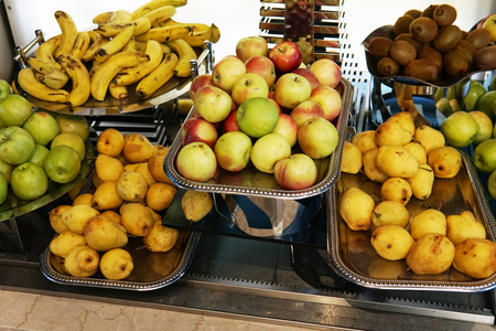 plates with fresh fruit in the kitchen citrus apples healthy