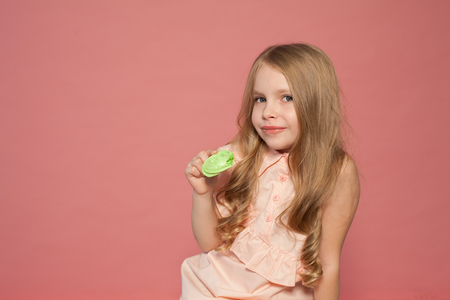 little girl eat sweet cake with cream cupcake Stok Fotoğraf