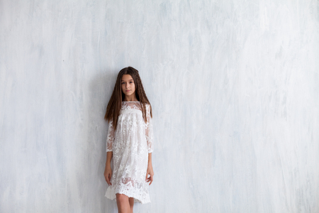 fashion girl 12 years old in a white dress