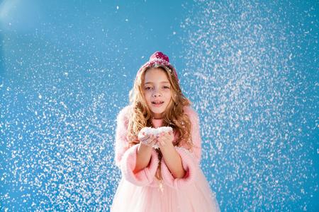 Portrait of beautiful girls under snow in winter