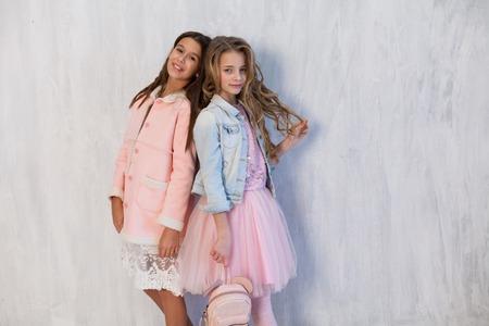 two fashionable girls girlfriend in school uniforms Stok Fotoğraf