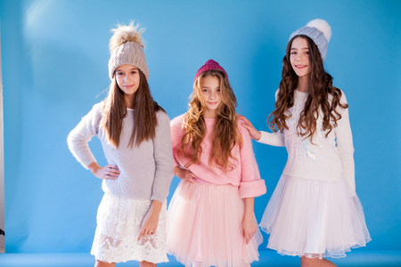 three fashionable girls girlfriend in winter knitted hats Stok Fotoğraf