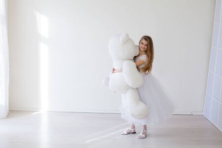 Beautiful girl with soft toy big bear