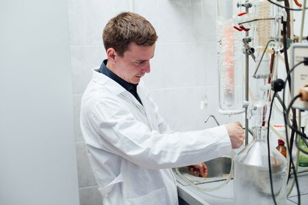 scientist conducts chemical experiments in the laboratory