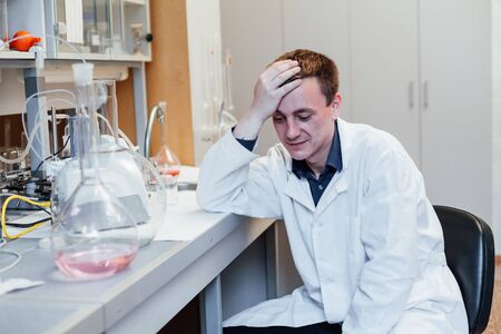 Scientist sleeps at work in the lab Stock Photo