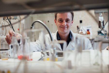 Scientist in a laboratory analyzes lab. analysis, dna, bio, microbiology