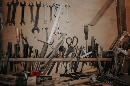 carpenter tools to work on a wooden background