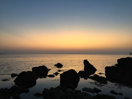 sunset landscape of the sea rocky coast Stock Photo