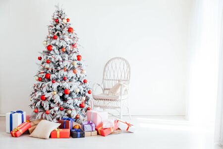 White Christmas tree with gifts and decorations the lights new year Garland