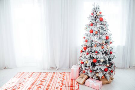 Merry Christmas gifts Interior white room holidays new year tree