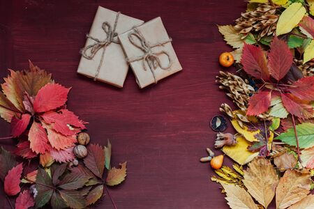 yellow and red leaves gifts autumn red background