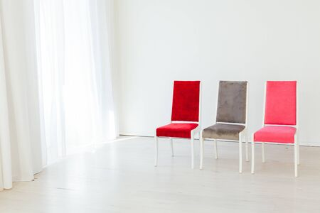 three chairs stand in an empty room Stok Fotoğraf