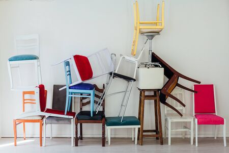 many different chairs stand in the room